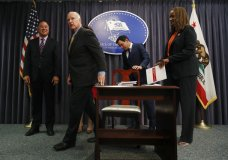 California Gov. Jerry Brown, second from left, leaves with Assemblymember Phil Ting, from left, Assembly Speaker Anthony Rendon and budget chair Senator Holly Mitchell after signing a budget bill Wednesday, June 27, 2018, in Los Angeles. Brown signed his 16th and final spending plan Wednesday alongside legislative leaders in Los Angeles. Brown leaves office early next year after a record four terms, first serving in the 1970s and 1980s and again since 2011. (AP Photo/Jae C. Hong)