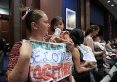 Lucy Martin and her daughter Branwen Espinal together with other mothers and their babies, attend a House Committee on the Judiciary and House Committee on Oversight and Government Reform hearing, to express their support and sympathy to immigrants and their families and objection to the forced separation of migrant children from their parents, on Capitol Hill in Washington, Tuesday, June 19, 2018. (AP Photo/Manuel Balce Ceneta)