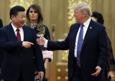 FILE - In this Nov. 9, 2017, file photo, U.S. President Donald Trump China's President Xi Jinping arrive for the state dinner with the first ladies at the Great Hall of the People in Beijing, China. Trump is closing in on a decision to impose punishing tariffs on tens of billions of dollars of Chinese goods as early as June 15, a move that could put his trade policies on a collision course with his push to rid the Korean Peninsula of nuclear weapons. Trump has long vowed to fulfill his campaign pledge to clamp down on what he considers unfair Chinese trading practices. But his calls for about $50 billion in tariffs could complicate his efforts to maintain China's support in his negotiations with North Korea. (Thomas Peter/Pool Photo via AP, File)