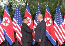 In this image made from video provided by Host Broadcaster Mediacorp Pte Ltd, U.S. President Donald Trump and North Korean leader Kim Jong Un shake hands ahead of their meeting at Capella Hotel in Singapore, Tuesday, June 12, 2018. (Host Broadcaster Mediacorp Pte Ltd via AP)