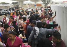 In this Monday, June 4, 2018 photo, people seeking political asylum in the United States line up to be interviewed in Tijuana, Mexico, just across the U.S. border south of San Diego. The Trump administration's fighting words for asylum seekers don't appear to be having much impact at U.S. border crossings with Mexico. Lines keep growing, so much that U.S. authorities can't take them all at once. (AP Photo/Elliot Spagat)