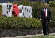 President Donald Trump arrives to participate in the G7 Summit welcome ceremony, Friday, June 8, 2018, in Charlevoix, Canada. (AP Photo/Evan Vucci)