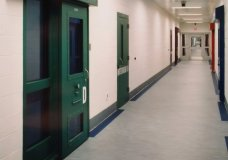 This image provided by the Shenandoah Valley Juvenile Center shows part of the interior of the building in Staunton, Va. Immigrant children as young as 14 housed at the juvenile detention center say they were beaten while handcuffed and locked up for long periods in solitary confinement, left nude and shivering in concrete cells. The abuse claims are detailed in federal court filings that include a half-dozen sworn statements from Latino teens jailed there for months or years. (Shenandoah Valley Juvenile Center via AP)