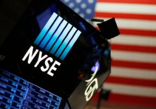 FILE - In this Dec. 27, 2017, file photo, a logo for the New York Stock Exchange is displayed above the trading floor. The U.S. stock market opens at 9:30 a.m. EDT on Thursday, July 5, 2018. (AP Photo/Mark Lennihan, File)