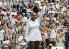 Serena Williams of the United States waves as she celebrates defeating Bulgaria's Viktoriya Tomova in their women's singles match, on the third day of the Wimbledon Tennis Championships in London, Wednesday July 4, 2018. (AP Photo/Kirsty Wigglesworth)