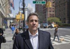 "FILE - In this April 11, 2018, file photo, attorney Michael Cohen walks down the sidewalk in New York. Cohen, President Donald Trump's longtime personal lawyer who is under investigation by federal prosecutors in New York, said in his Twitter post Sunday, July 1, that he sat down for an interview with ABC News and his ""silence is broken."" (AP Photo/Seth Wenig, File)"