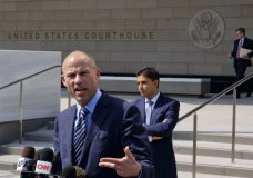 Michael Avenatti, the attorney for porn actress Stormy Daniels replies to questions by reporters during a news conference in front of the U.S. Federal Courthouse in Los Angeles on Friday, July 27,2018. (AP Photo/Richard Vogel)
