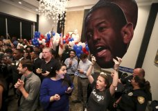 Rachelle Clegg holds an Andrew Gillum cutout as she cheers on gubernatorial candidate Andrew Gillum at his watch party at Hotel Duval in downtown Tallahassee, Fla., Tuesday, Aug. 28, 2018. (Joe Rondone/Tallahassee Democrat via AP)