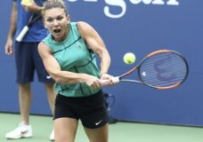 FILE - In this Friday Aug. 24, 2018, file photo, Simona Halep, of Romania, practices at the USTA Billie Jean King National Tennis Center in New York. The director of the Connecticut Open tennis tournament says there have been too many player withdrawals and retirements from events such as hers this summer and the WTA needs to address the problem. The New Haven tournament lost top-seed Halep, and numerous other players to minor injuries and illness. (Photo by Greg Allen/Invision/AP, File)