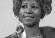 """FILE - In this March 13, 1972 file photo, Aretha Franklin holds her Grammy Award for Best Rhythm and Blue performance of the song """"Bridge Over Troubled Waters,"""" in New York. Franklin died Thursday, Aug. 16, 2018 at her home in Detroit. She was 76. (AP Photo/Dave Pickoff, File)"""
