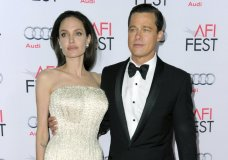 """FILE - In this Nov. 5, 2015 file photo, Angelina Jolie, left, and Brad Pitt arrive at the 2015 AFI Fest opening night premiere of """"By The Sea"""" in Los Angeles. Jolie Pitt says she wants her divorce from Brad Pitt finalized before the end of the year, and that she intends to seek retroactive child support. The declarations came in a request for a case-management conference filed Tuesday by Jolie Pitt's attorneys in Los Angeles Superior Court. (Photo by Richard Shotwell/Invision/AP, File)"""