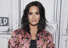 "FILE - In this March 20, 2017 file photo, Demi Lovato participates in the BUILD Speaker Series to discuss ""Smurfs: The Lost Village"" in New York. Lovato has checked out of the hospital she was rushed to two weeks ago for a reported overdose. A person close to Lovato says she was released from Cedars-Sinai hospital in Los Angeles over the weekend. Lovato was hospitalized on July 24. (Photo by Charles Sykes/Invision/AP, File)"