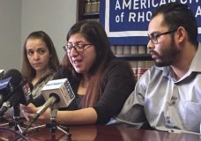 FILE - In this Feb. 14, 2018, file photo, Lilian Calderon, center, cries as she describes her experiences while in custody, alongside her husband, Luis Gordillo, right, during a news conference at the office of the American Civil Liberties Union in Providence, R.I. Gordillo is a U.S. citizen, but Calderon is a native of Guatemala who came to the country with her family at the age of 3. She was ordered to leave in 2002 after her father was denied asylum. (AP Photo/Michelle R. Smith, File)