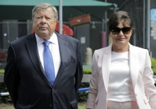 Viktor and Amalija Knavs listen as their attorney makes a statement in New York, Thursday, Aug. 9, 2018. First lady Melania Trump's parents have been sworn in as U.S. citizens. A lawyer for the Knavs says the Slovenian couple took the citizenship oath on Thursday in New York City. They had been living in the U.S. as permanent residents. (AP Photo/Seth Wenig)