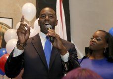 Andrew Gillum with his wife, R. Jai Gillum at his side addresses his supporters after winning the Democrat primary for governor on Tuesday, Aug. 28, 2018, in Tallahassee, Fla. (AP Photo/Steve Cannon)