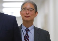 """In this Aug. 28, 2018, file photo, Justice Department official Bruce Ohr arrives for a closed hearing of the House Judiciary and House Oversight committees on Capitol Hill in Washington. A former British spy told Ohr, a senior Justice Department lawyer, at a breakfast meeting on July 30, 2016, that Russian intelligence believed it had Donald Trump """"over a barrel,"""" according to multiple people familiar with the encounter. (AP Photo/Pablo Martinez Monsivais)"""