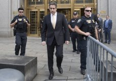 In this Aug. 21, 2018, photo, Michael Cohen, center, leaves federal court in New York. President Donald Trump has long demanded loyalty from his friends and associates. But he has been learning the hard way that in politics those relationships come and go. A key defection came this week when Cohen, Trump's former personal attorney, implicated the president in a stunning plea deal, followed by a longtime friend and media boss cooperating with prosecutors. (AP Photo/Mary Altaffer)