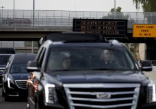 A motorcade carrying the the casket of Sen. John McCain, R-Ariz. travels from the Arizona Capitol to the North Phoenix Baptist Church for a memorial service on Thursday, Aug. 30, 2018, in Phoenix. (AP Photo/Jae C. Hong)