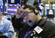 Trader Michael Capolino works on the floor of the New York Stock Exchange, Friday, Aug. 10, 2018. Stocks are opening moderately lower on Wall Street following steeper losses in Europe, where investors worried about a sharp drop in Turkey's currency. (AP Photo/Richard Drew)
