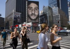People walk by a Nike advertisement featuring Colin Kaepernick on display, Thursday, Sept. 6, 2018, in New York. Nike this week unveiled the deal with the former San Francisco 49ers quarterback, who's known for starting protests among NFL players over police brutality and racial inequality. (AP Photo/Mark Lennihan)