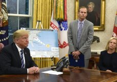 President Donald Trump, left, listens to a reporters question as FEMA Administrator Brock Long, center, and Homeland Security Secretary Kirstjen Nielsen, right, listen during a briefing on Hurricane Florence in the Oval Office of the White House in Washington, Tuesday, Sept. 11, 2018. (AP Photo/Susan Walsh)