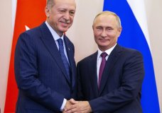 Russian President Vladimir Putin, right, and Turkish President Recep Tayyip Erdogan shake hands after their joint news conference following the talks in the Bocharov Ruchei residence in the Black Sea resort of Sochi in Sochi, Russia, Monday, Sept. 17, 2018. Turkish President Recep Tayyip Erdogan meets for the second time in 10 days with Russia's Vladimir Putin. (AP Photo/Alexander Zemlianichenko, Pool)