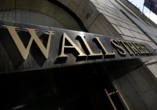 FILE- This April 5, 2018, file photo shows a building's address on Wall Street in New York. The U.S. stock market opens at 9:30 a.m. EDT on Thursday, Sept. 6. (AP Photo/Richard Drew, File)
