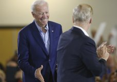 Former Vice-President Joe Biden, left, greets U.S. Sen. Bill Nelson before giving a speech during the Florida Democratic Party rally held at the University of South Florida in Tampa, Florida on Monday, October 22, 2018. (Octavio Jones/The Tampa Bay Times via AP)