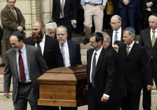 A casket is carried out of Rodef Shalom Congregation after the funeral services for brothers Cecil and David Rosenthal, Tuesday, Oct. 30, 2018, in Pittsburgh. The brothers were killed in the mass shooting last week at the Tree of Life Synagogue. (AP Photo/Matt Rourke)