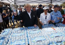 President Donald Trump and first lady Melania Trump hand out water during a visit to areas affected by Hurricane Michael, Monday, Oct. 15, 2018, in Lynn Haven, Fla. Florida Gov. Rick Scott is right. (AP Photo/Evan Vucci)