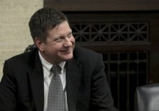 Chicago police Officer Jason Van Dyke smiles as he listens to his attorney as the jury has sent another question to Judge Vincent Gaughan bench, who read it aloud from the bench during deliberations in Van Dyke's trial at the Leighton Criminal Court Building, Friday, Oct. 5, 2018, in Chicago. Van Dyke is charged with first-degree murder, aggravated battery and official misconduct in the shooting of Laquan McDonald. (Antonio Perez/ Chicago Tribune via AP, Pool)