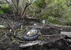 Debris scatters an area Sunday, Oct. 7, 2018, at the site of yesterday's fatal crash Schoharie, N.Y. (AP Photo/Hans Pennink)