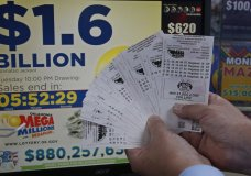 A customer, who did not want to be identified, displays the $200.00 worth of Mega Millions tickets he bought at Downtown Plaza convenience store in Oklahoma City, Tuesday, Oct. 23, 2018. (AP Photo/Sue Ogrocki)