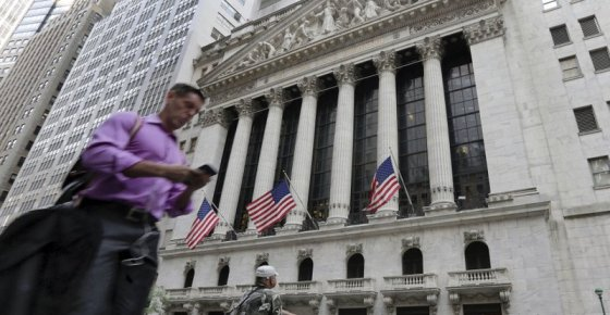 FILE - In this June 24, 2016, file photo, a man walks by the New York Stock Exchange. The U.S. stock market opens at 9:30 a.m. EDT on Friday, Oct. 12, 2018. (AP Photo/Richard Drew, File)