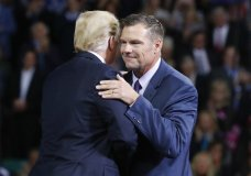President Donald Trump, left, on stage with Republican gubernatorial candidate Secretary of State Kris Kobach, right, during a campaign rally at Kansas Expocentre, Saturday, Oct. 6, 2018 in Topeka, Kan. (AP Photo/Pablo Martinez Monsivais)