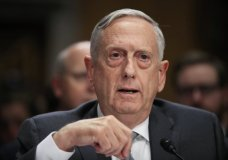 FILE - In this Oct. 30, 2017, file photo, Secretary of Defense Jim Mattis, testifies during a Senate Foreign Relations Committee on Capitol Hill in Washington. US officials say stricter Trump administration immigration policies have stymied Pentagon plans to restart a program that allowed thousands of people with critical medical or Asian and African language skills to join the military and become American citizens. (AP Photo/Manuel Balce Ceneta, File)