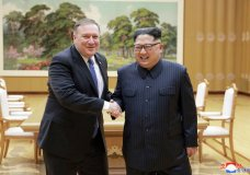 "FILE - In this May 9, 2018, file photo provided by the North Korean government, U.S. Secretary of State Mike Pompeo, left, shakes hands with North Korean leader Kim Jong Un during a meeting at Workers' Party of Korea headquarters in Pyongyang, North Korea. North Korea warned Washington through its state media Tuesday, Oct. 2, that a declaration ending the Korean War shouldn't be seen as a bargaining chip in denuclearization talks — but suggested lifting sanctions might be. Independent journalists were not given access to cover the event depicted in this image distributed by the North Korean government. The content of this image is as provided and cannot be independently verified. Korean language watermark on image as provided by source reads: ""KCNA"" which is the abbreviation for Korean Central News Agency. (Korean Central News Agency/Korea News Service via AP, File)"