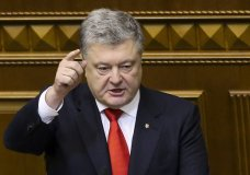 Ukrainian President Petro Poroshenko gestures during a parliament session in Kiev, Ukraine, Monday, Nov. 26, 2018. Ukrainian parliament has voted to impose martial law for 30 days in wake of Russian seizure of Ukrainian vessels. (AP Photo/Efrem Lukatsky)