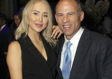 """In this September 2018 photo, attorney Michael Avenatti, right, poses with Mareli Miniutti for a photo at a party in New York. Miniutti alleges that Avenatti dragged her across the floor of his Los Angeles apartment after an argument over money, according to court documents obtained Tuesday, Nov. 20, 2018, by The Associated Press. Avenatti, who was arrested the week before on a felony domestic violence charge, called the allegations """"completely false."""" He's scheduled to appear in court in December 2018. (Marion Curtis/StarPix via AP)"""