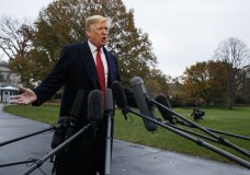President Donald Trump talks with reporters before departing for France on the South Lawn of the White House, Friday, Nov. 9, 2018, in Washington. (AP Photo/Evan Vucci)