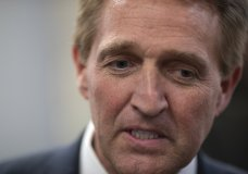 Sen. Jeff Flake, R-Ariz., speaks with reporters before he and Sen. Chris Coons, D-Del., try to bring up the legislation to protect special counsel Robert Mueller, at the Capitol in Washington, Wednesday, Nov. 14, 2018. Senate Republicans are facing renewed pressure to pass legislation to protect Mueller, with a handful of GOP senators urging their leadership to hold a vote now that President Donald Trump has pushed out Attorney General Jeff Sessions. (AP Photo/J. Scott Applewhite)