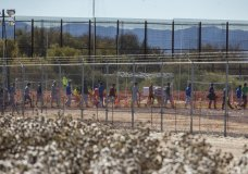 In this Nov. 15, 2018 photo provided by Ivan Pierre Aguirre, migrant teens are led in a line inside the Tornillo detention camp holding more than 2,300 migrant teens in Tornillo, Texas. The Trump administration announced in June 2018 that it would open the temporary shelter for up to 360 migrant children in this isolated corner of the Texas desert. Less than six months later, the facility has expanded into a detention camp holding thousands of teenagers - and it shows every sign of becoming more permanent. (Ivan Pierre Aguirre via AP)