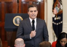 FILE - In this Nov. 7, 2018, file photo, CNN journalist Jim Acosta does a standup before a new conference with President Donald Trump in the East Room of the White House in Washington. CNN sued the Trump administration Tuesday, demanding that correspondent Jim Acosta's credentials to cover the White House be returned because it violates the constitutional right of freedom of the press. (AP Photo/Evan Vucci, File)