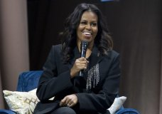 """FILE - In this Nov. 17, 2018 file photo, former first lady Michelle Obama speaks to the crowd as she presents her anticipated memoir """"Becoming"""" during her book tour stop in Washington. Crown Publishing tells The Associated Press on Wednesday that the former first lady's memoir has sold more than 1.4 million copies in all formats in the U.S. and Canada in the seven days since it was released Nov. 13. (AP Photo/Jose Luis Magana, File)"""
