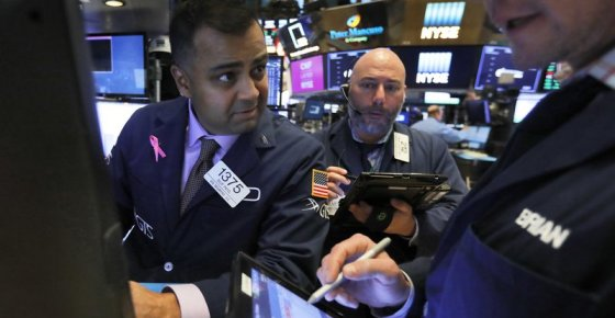 FILE- In this Thursday, Nov. 8, 2018, file photo, specialist Dilip Patel, left, works at his post on the floor of the New York Stock Exchange. The U.S. stock market opens at 9:30 a.m. EDT on Thursday, Nov. 15. (AP Photo/Richard Drew, File)