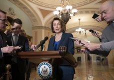 House Democratic Leader Nancy Pelosi talks to reporters after meeting with Senate Minority Leader Chuck Schumer, D-N.Y. (AP Photo/J. Scott Applewhite)