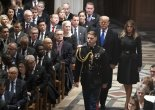 President Donald Trump and first lady Melania Trump arrive at the state funeral of former President George H.W. Bush at the Washington National Cathedral (AP Photo/Carolyn Kaster)