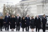 From right, former President George W. Bush, second from right, former first lady Laura Bush, Neil Bush, Sharon Bush, Bobby Koch, Doro Koch, Jeb Bush and Columba Bush, stand just prior to the flag-draped casket of former President George H.W. Bush being carried by a joint services military honor guard from the U.S. Capitol, Wednesday, Dec. 5, 2018, in Washington. (AP Photo/Alex Brandon, Pool)