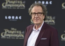 "FILE - In this May 18, 2017, file photo, Geoffrey Rush arrives at the Los Angeles premiere of ""Pirates of the Caribbean: Dead Men Tell No Tales"" at the Dolby Theatre. ""Orange Is the New Black"" actress Yael Stone alleges actor Geoffrey Rush engaged in sexually inappropriate behavior when they starred in ""The Diary of a Madman"" in 2010. (Photo by Jordan Strauss/Invision/AP, File)"