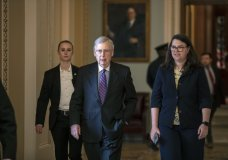 Senate Majority Leader Mitch McConnell, R-Ky., with Secretary for the Majority Laura Dove, right, walks from the chamber at the Capitol in Washington, Wednesday, Jan. 23, 2019. The Senate will vote on two competing proposals this week to end the partial government shutdown, but neither seems to have enough votes to advance. (AP Photo/J. Scott Applewhite)